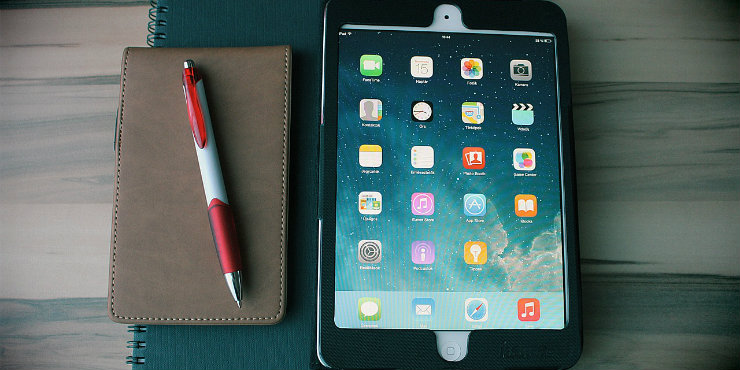 An iPad, notebook and pen