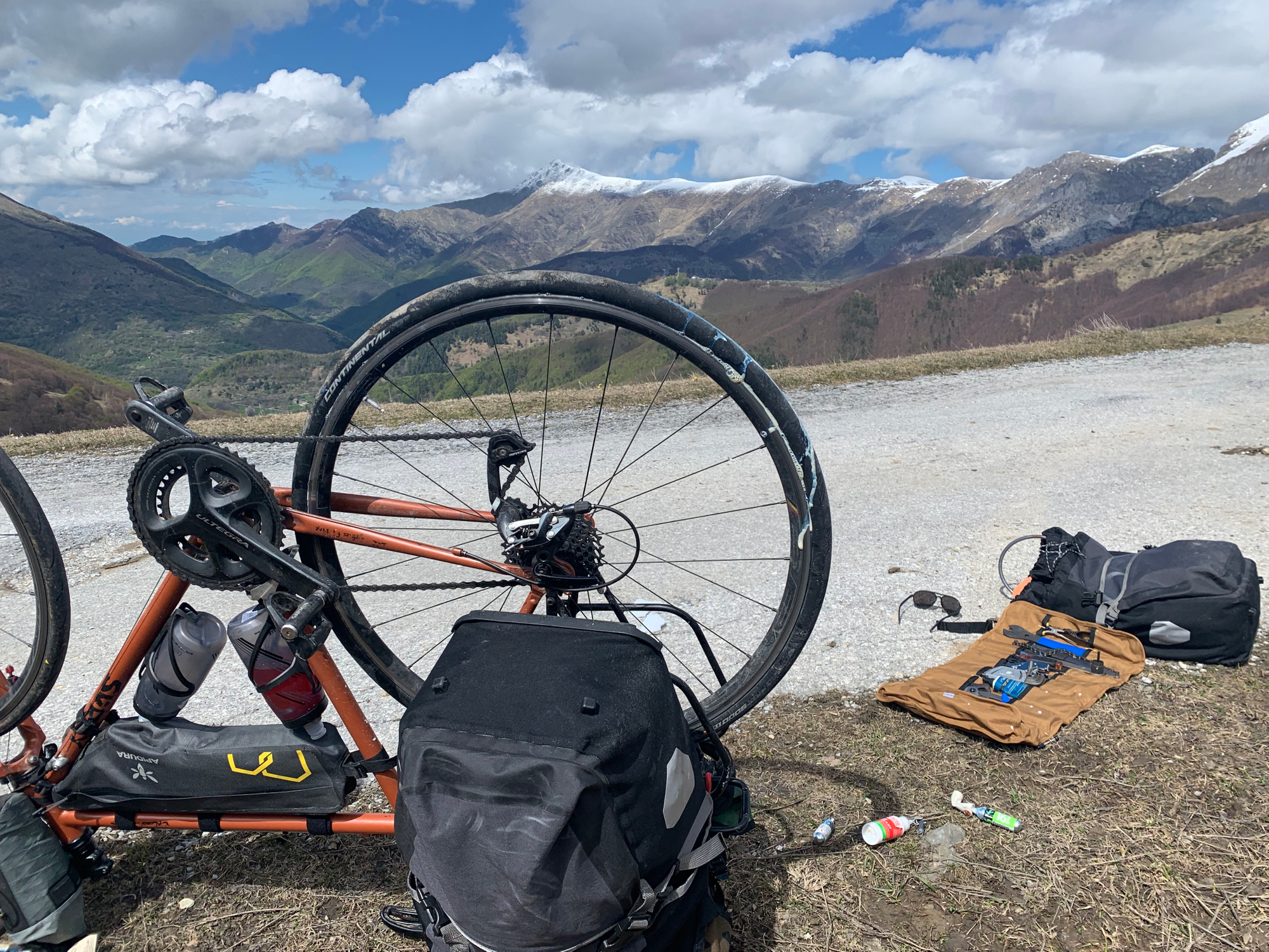 Dealing with tubeless tyre failure, replacing sealant and reseating a tyre, just after crossing from France to Italy still up in very nippy mountains.