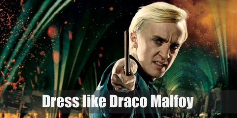 In the movie, Draco doesn't have a problem wearing muggle clothes and looks very dashing in his all black ensemble. But we're not here for that! Draco is from the cunning house of Slytherin and his house pride shines in his school robes.