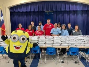 SA YES School Supply Distribution Back to Basics Project volunteers with minion
