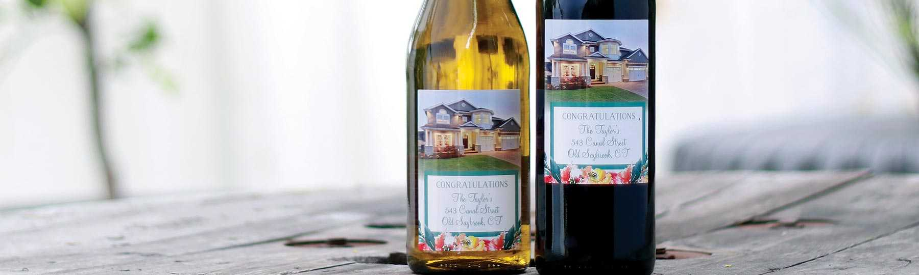 Custom labeled wine and custom labeled champagne real estate closing gifts by Etching Expressions