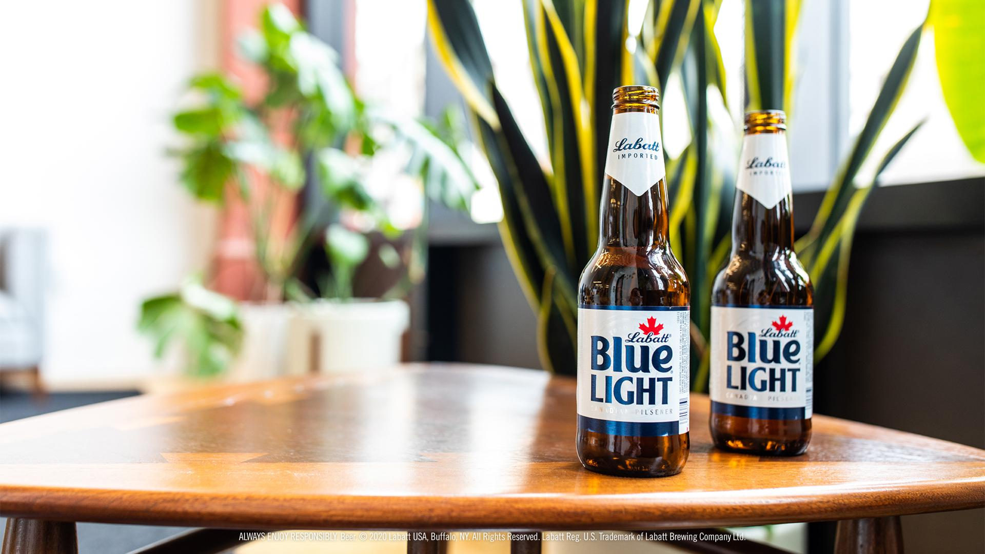 Blue Light Bottles on a Small Table with Plants in the Background