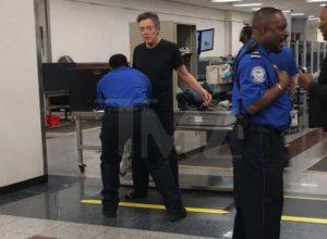 Man getting pat down screening at an airport