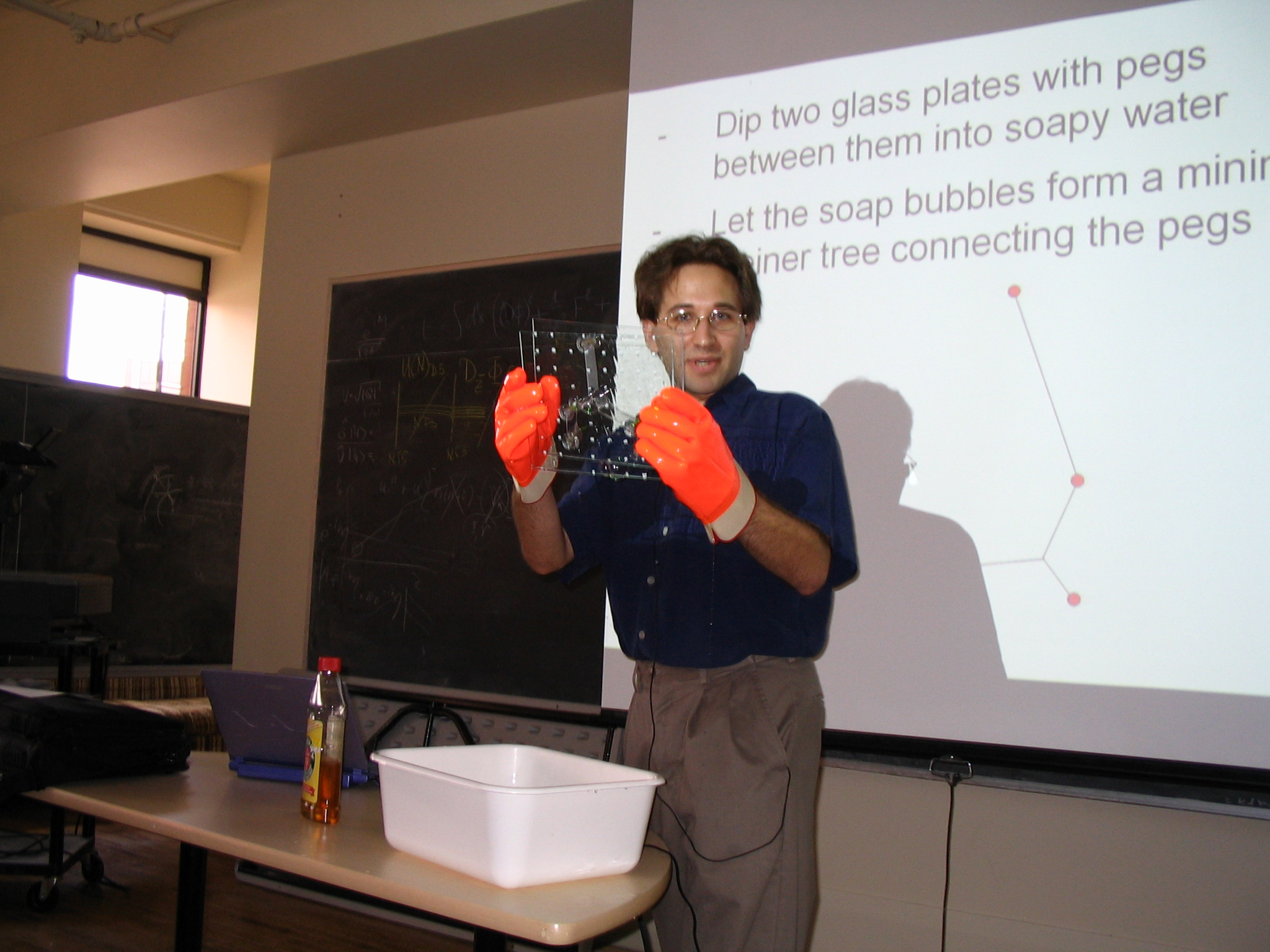 Scott Aaronson tests a candidate device for computing Steiner trees using soap bubbles.