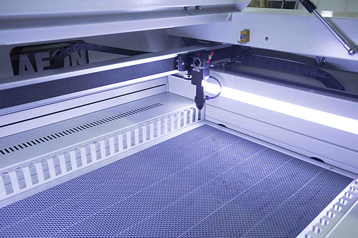 close up of the honeycomb table on the Aeon Nova CO2 Laser Engraver and Cutting Machine