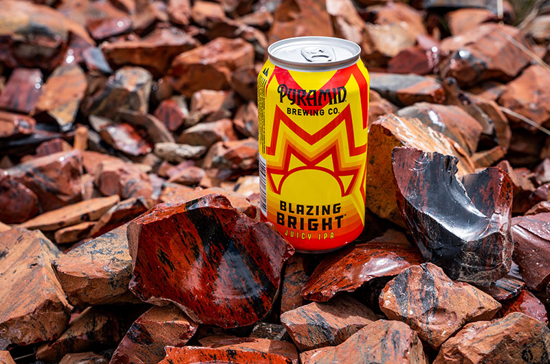 A can of Blazing Bright surrounded by sharp pieces of Black Obsidian