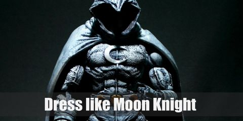 Moon Knight wears a black and white (mostly white) costume. He also loves his billowing hooded cape and full face mask.