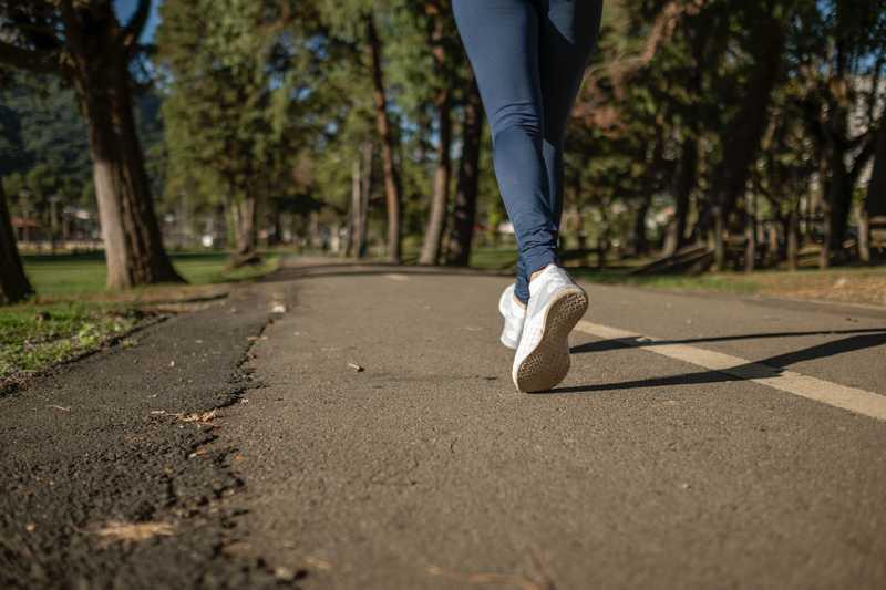 woman's legs running on path