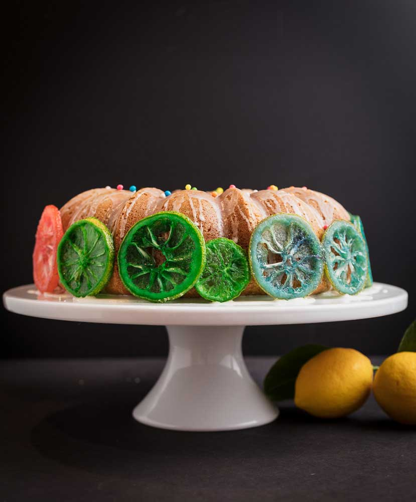 Vegan lemon cake with rainbow candied lemon slices