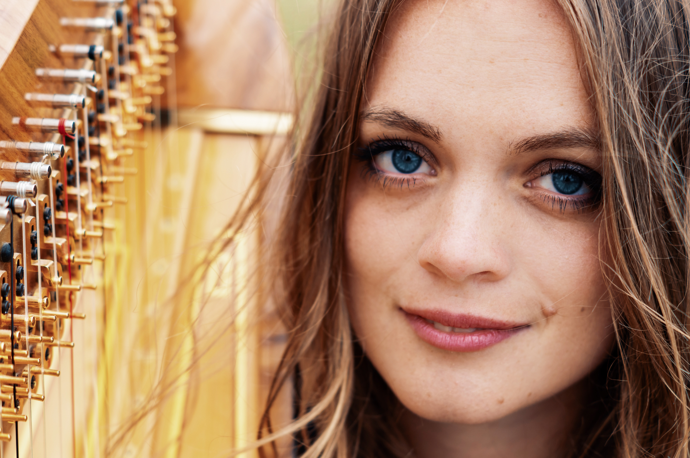 Up close portrait photography by Jack Watkins for award-winning classical musician and harpist, Lucy Nolan