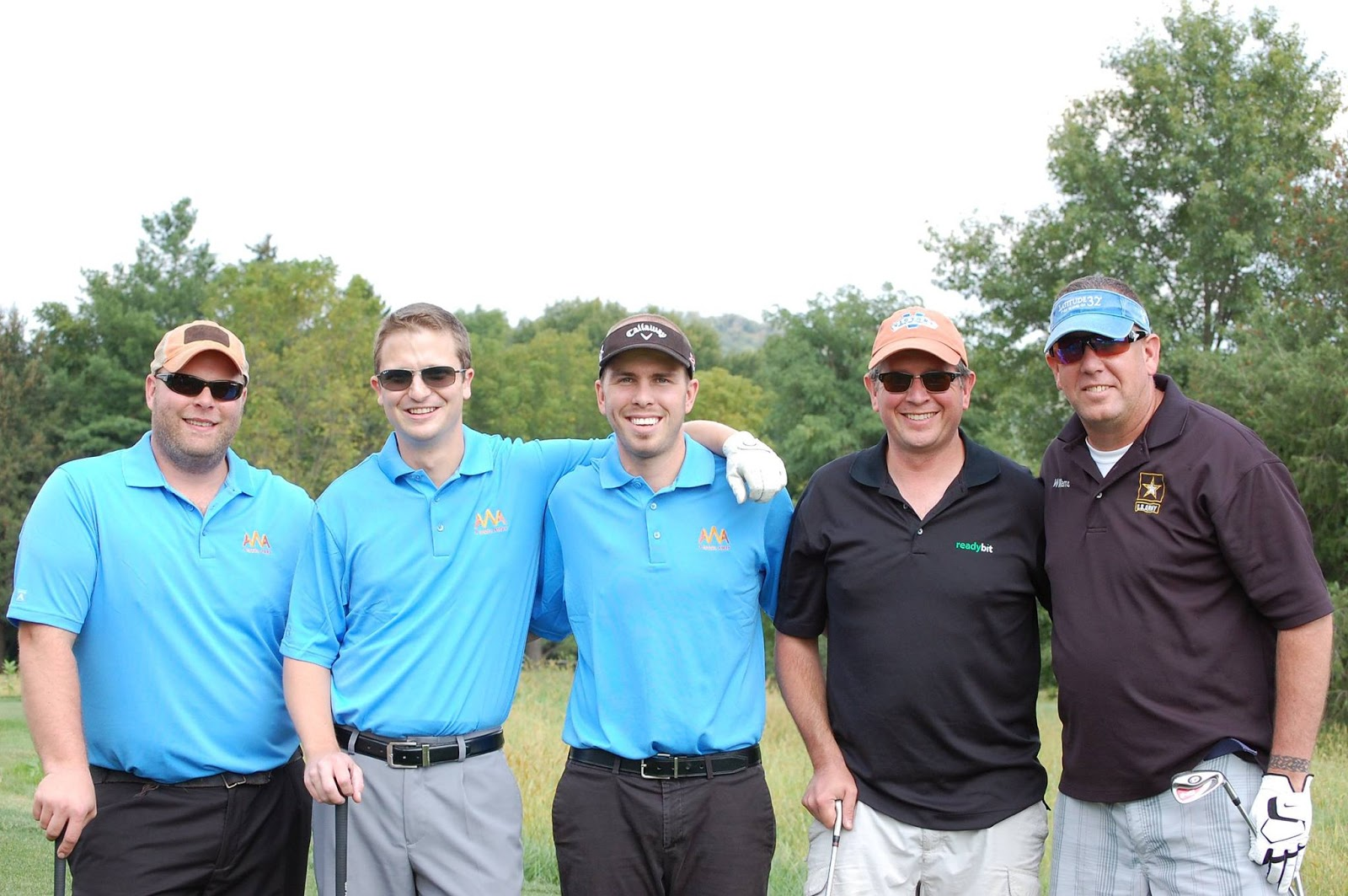 Caleb with AWA friends and supporters at the Golf Tournament in 2014