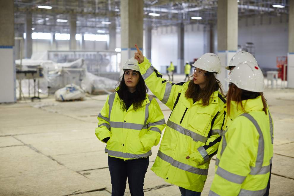 People in hi-viz jackets on a construction site