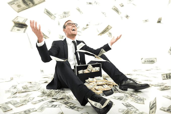 A successful man enjoying the money around him
