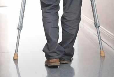 Person walking with crutches