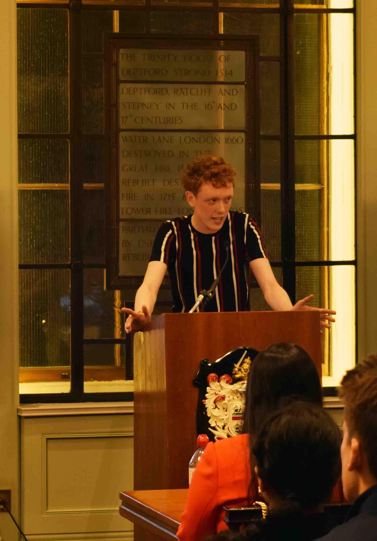 Joseph putting his public speaking skills to use at a university debate