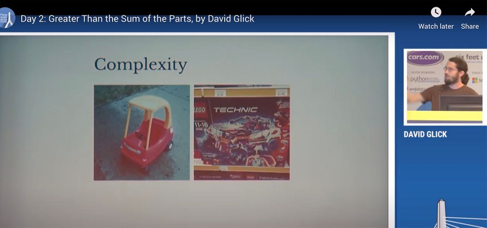David speaking about his slide showing legos and toy car