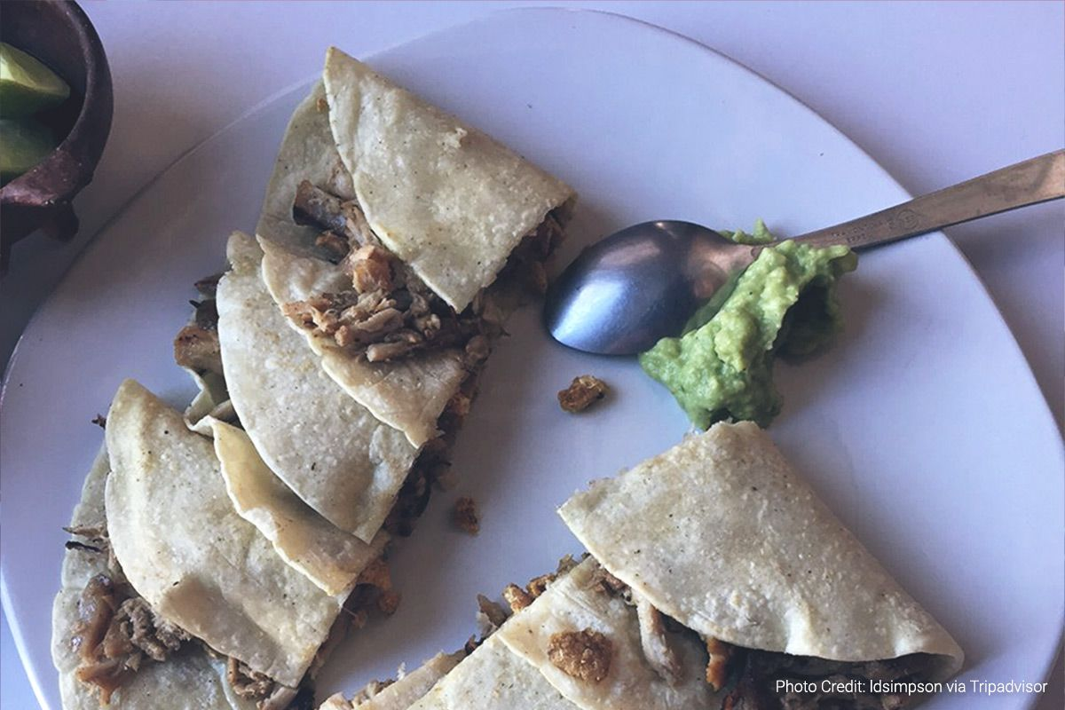 a plate of tacos with a dollop of guacamole from la popular, a restaurant in oaxaca mexico (photo credit: ldsimpson via tripadvisor)