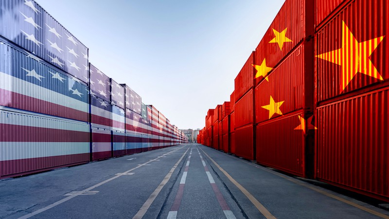 Metaphor image of United States of America and China trade war tariffs as two opposing container cargo and airplane over the port as an economic taxation dispute over import and exports concept