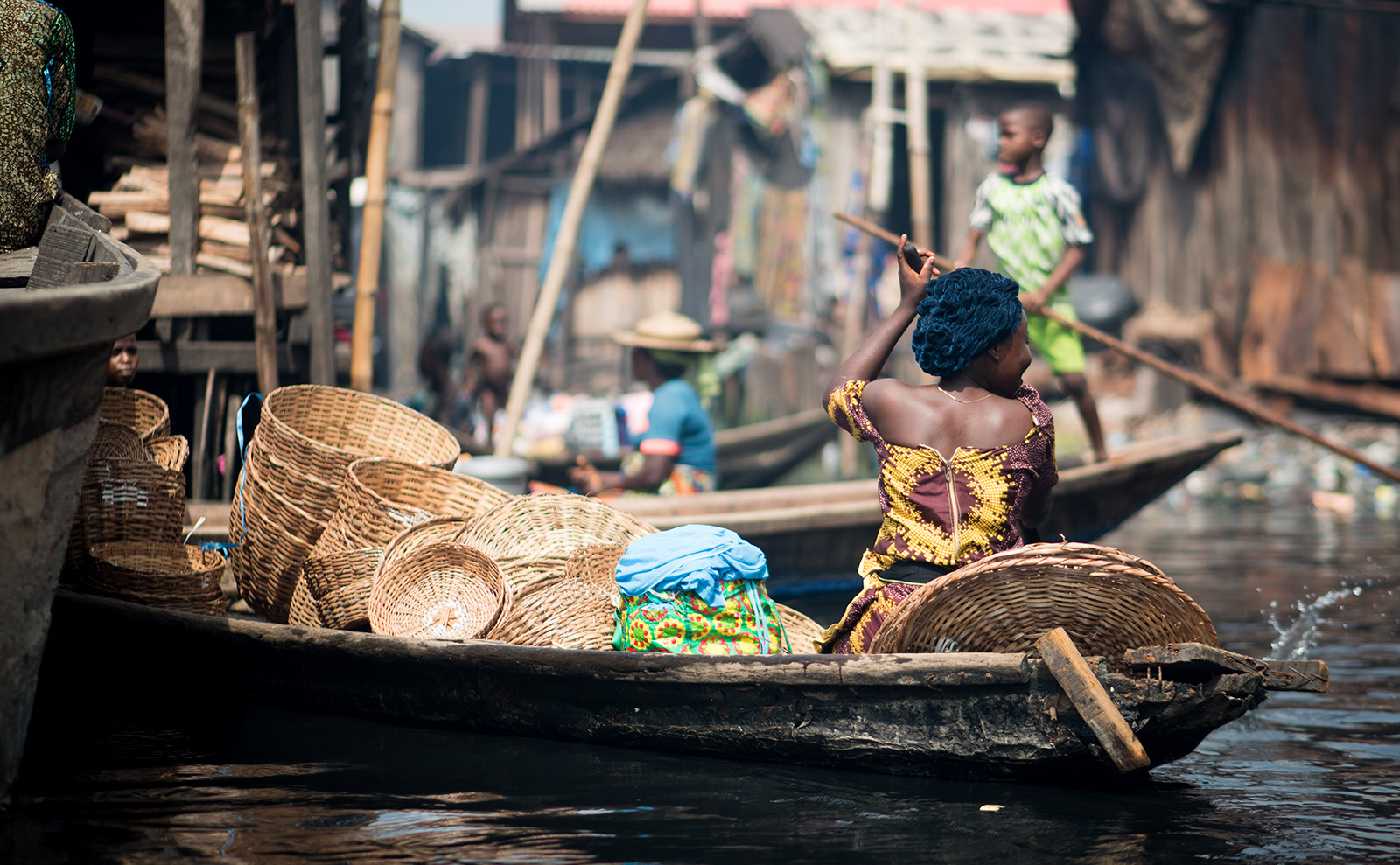 woman in a kayak in the waters of nigeria