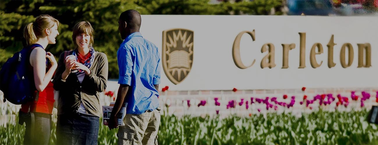 Students standing in front of the Carleton University sign