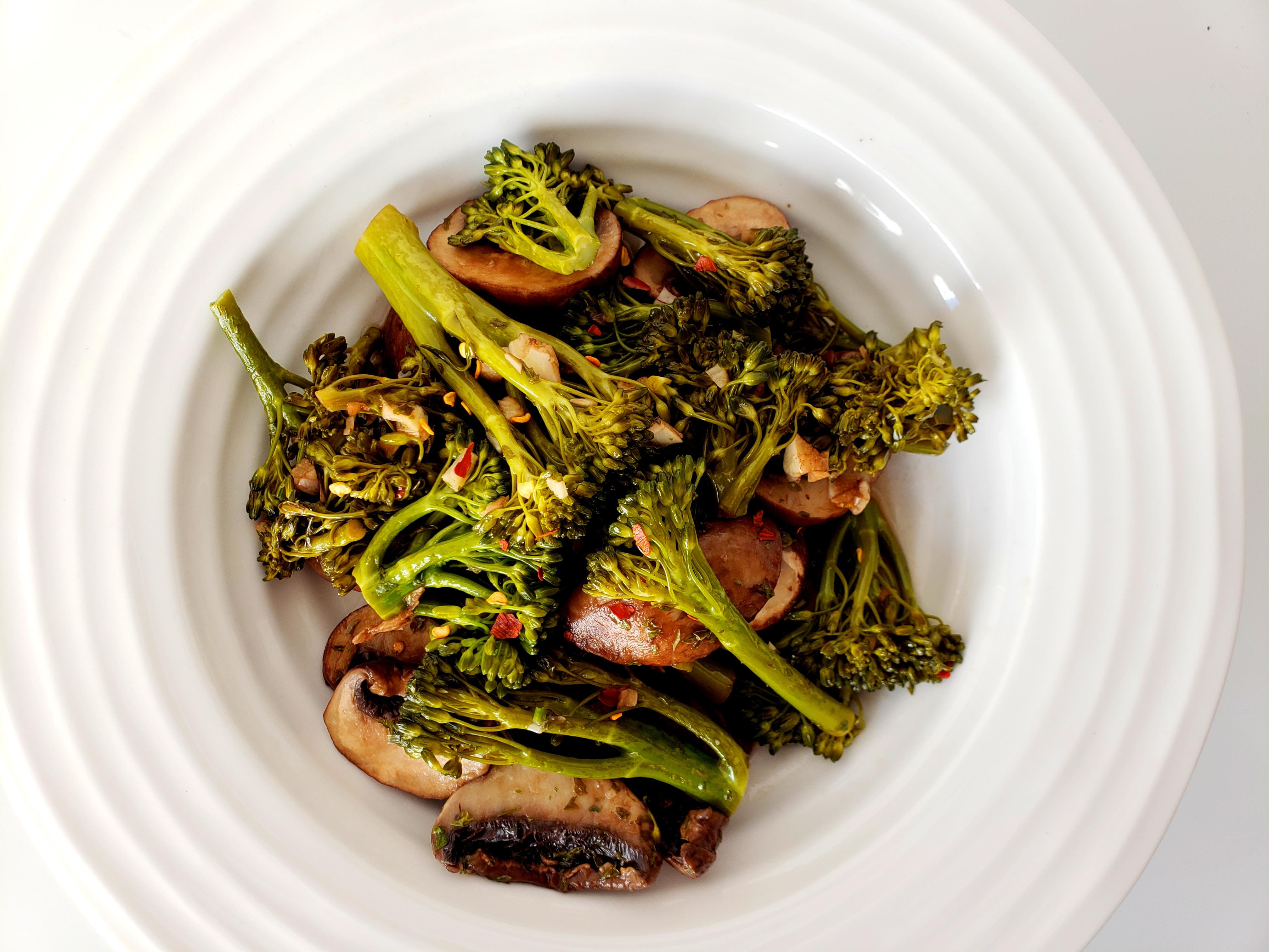 Bowl of balsamic broccolini and sliced mushrooms