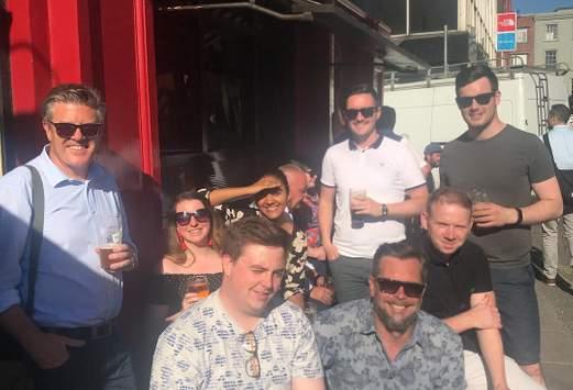 staff drinking outside pub