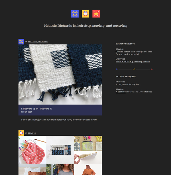The home page rendered with a very dark navy page background, and purplish-blue tiles for the blog post links instead of a blush color