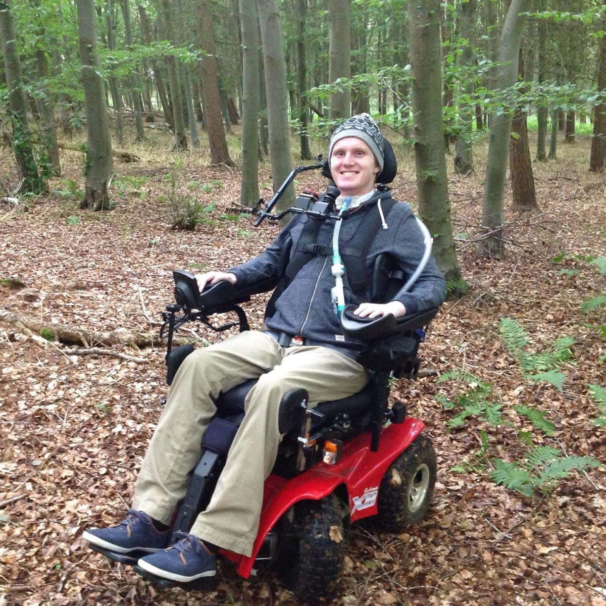 Man in wheelchair out for an adventure out in the woods