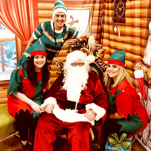 IAG Loyalty contact centre agents dressed up as Santa and his elves.
