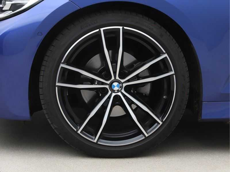 BMW 3 Serie 320i High Exe M-Sport Aut. afbeelding 22