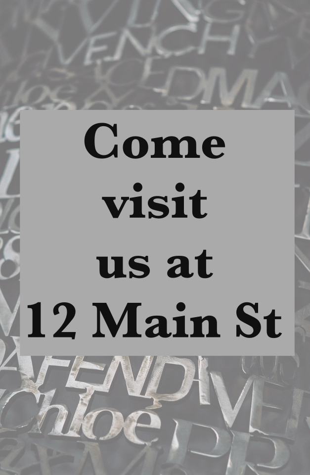"Foreground image: Bold text reading ""Come visit us at 12 Main St"" on gray background."