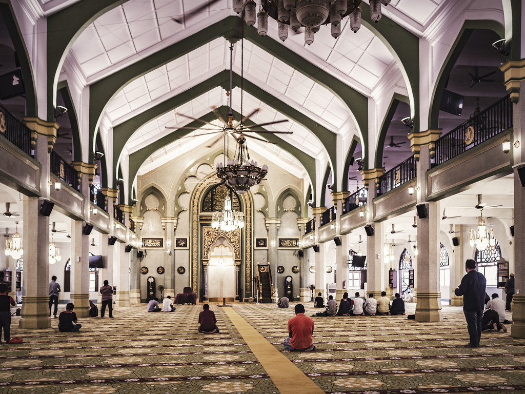 People praying inside the Masjid Sultan mosque in Singapore