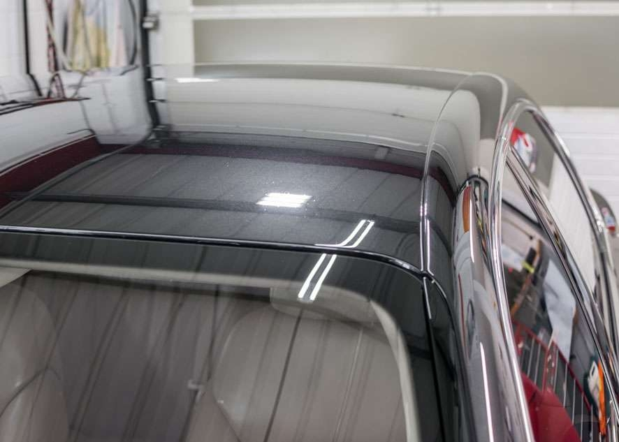 Close up shot of Bentley Flying Spur car after polishing, paint correction and paint enhancement with no scratches