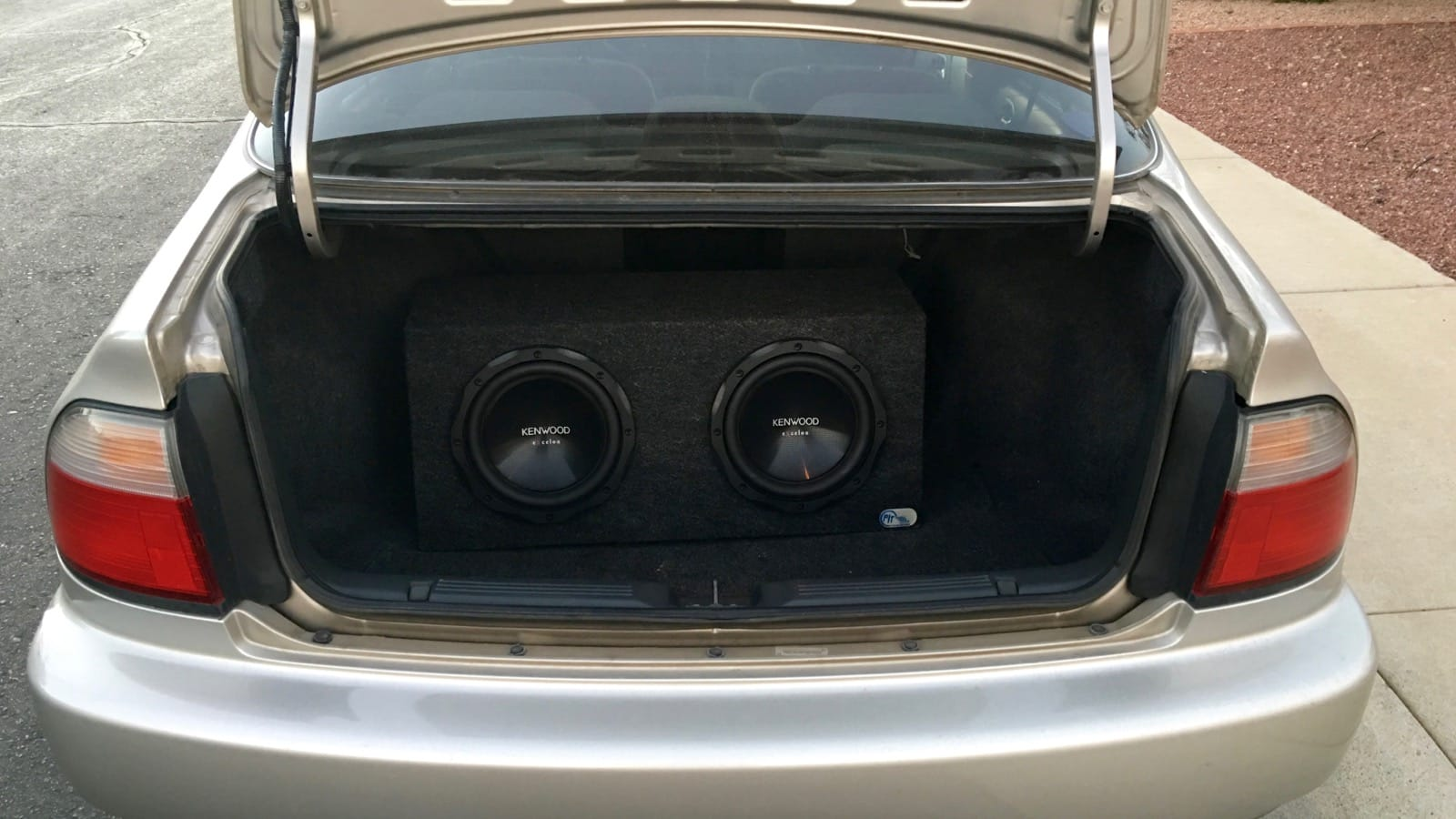 Twin 10-inch subwoofers in trunk of Honda Accord
