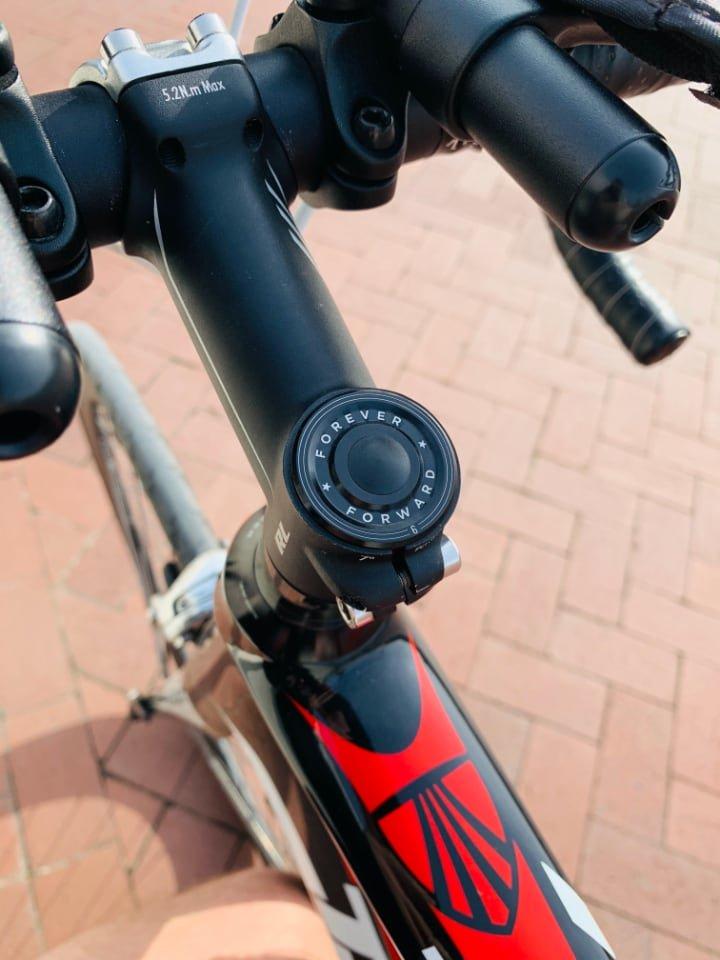 My bike's custom stem cover that says Forever Forward