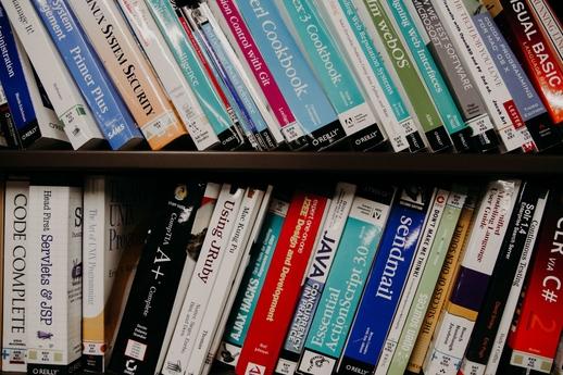 Tech books on a bookshelf