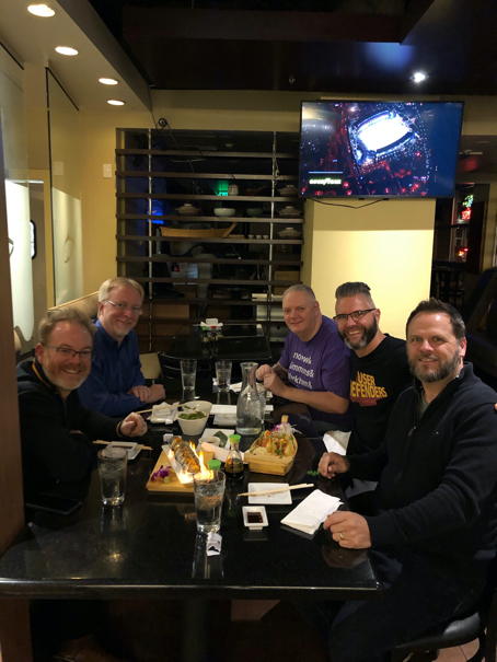From Left to right, Jason Pamental, Eric Meyer, Todd Libby, Jason Ogle, and Derek Featherstone sitting at a table at dinner in Denver, Colorado. Photo courtesy of Jason Ogle
