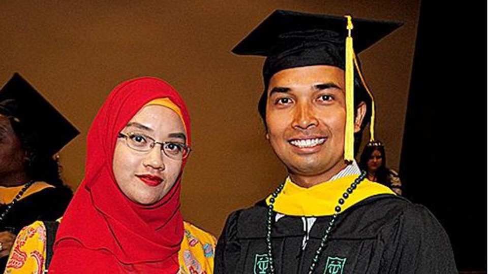 A woman on the left, a man using a graduate cap on the right