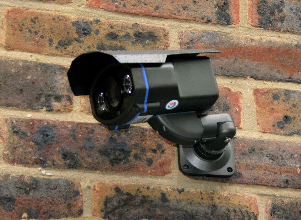 Wired CCTV system on wall 2