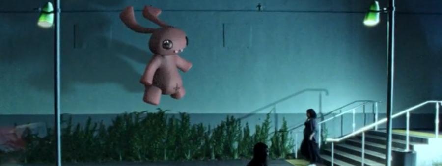 I'm All In music video still of floating rabbit at night