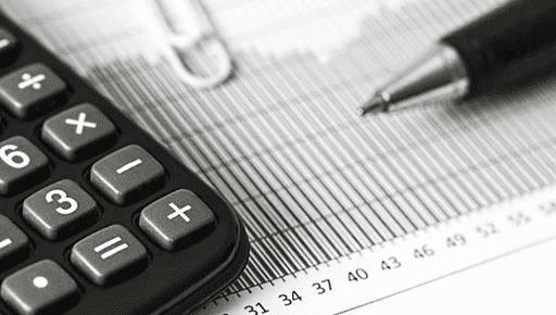 Pen and claculator lie on financial forms and graphs and documents for tax planning to introduce forecasting #forecasting