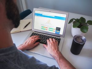Person using a macbook with Google Lighthouse test on the screen.