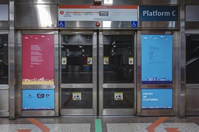 Two poems, one on each side, are shown on the MRT doors.