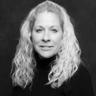 Portrait of Julie Overstreet, MBA, CRM