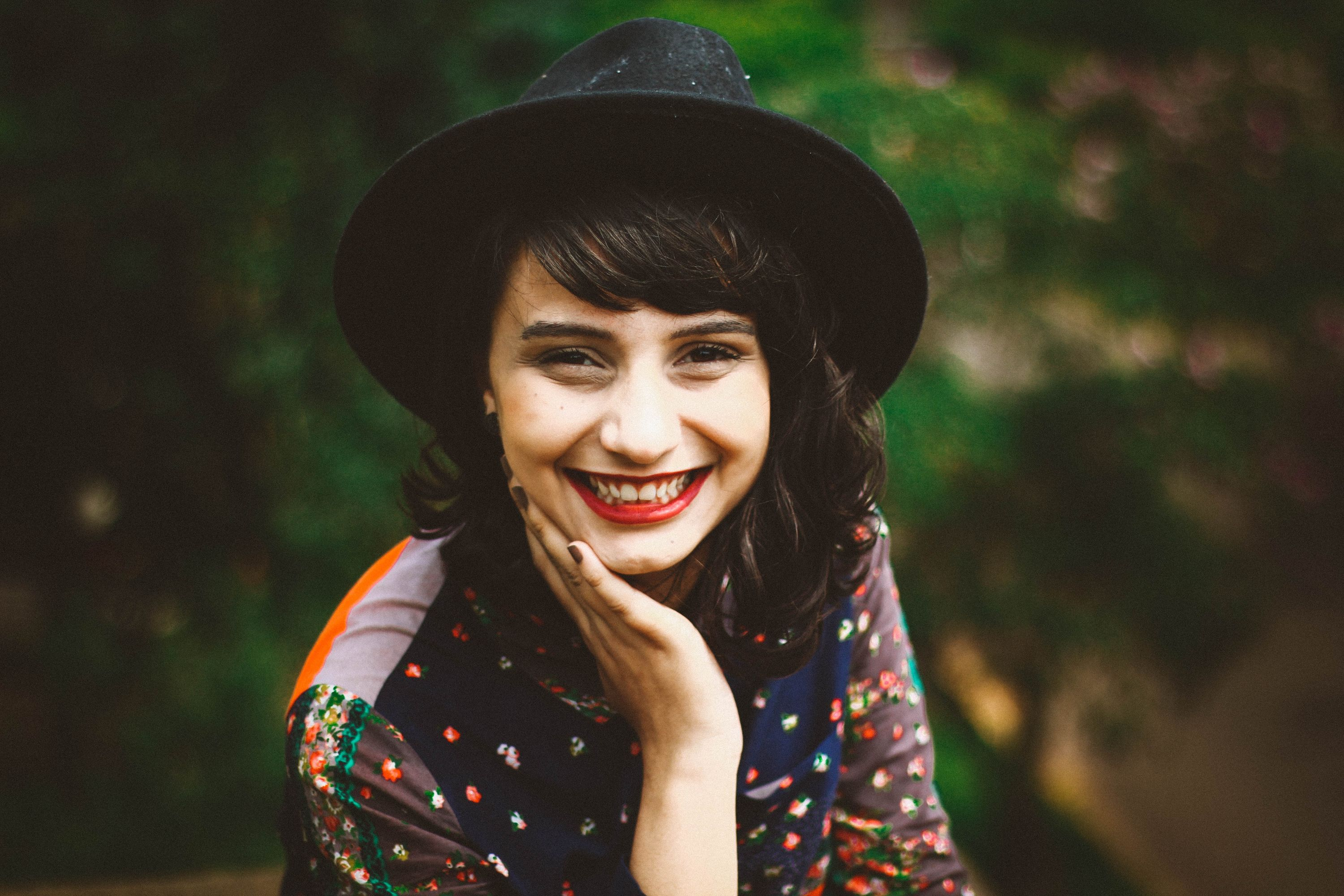 girl with hat and big smile