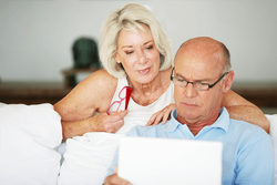 A couple calculating their adjusted gross income.