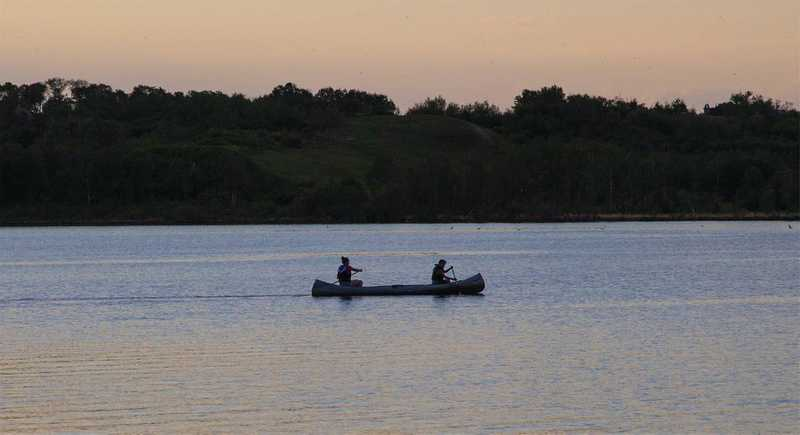 Two people canoeing on a Saskatchewan lake