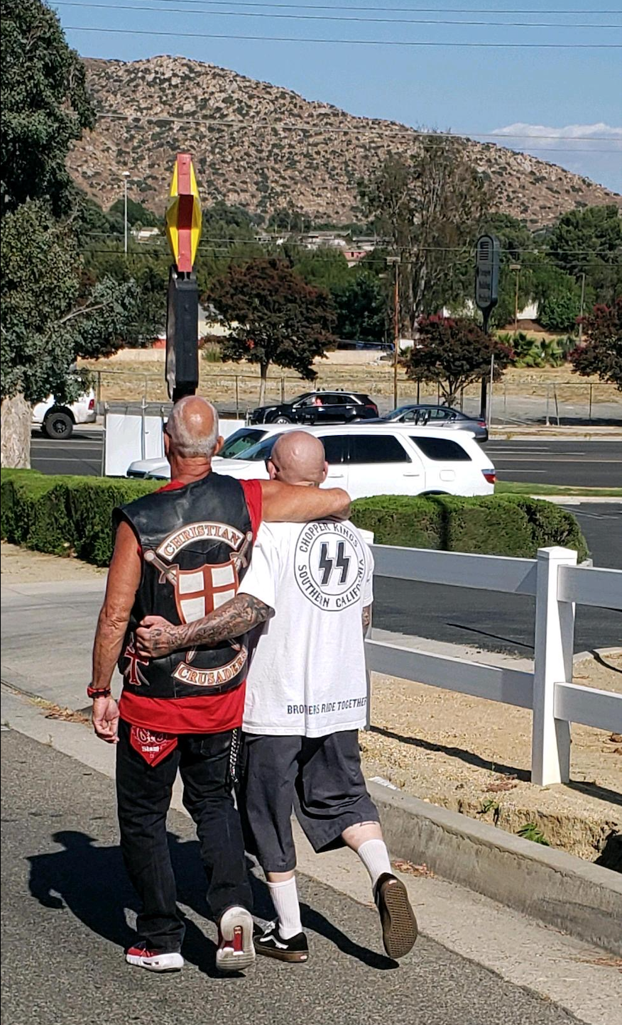 'Christian Crusaders' and Ryan Van De Car leaving the protest together. You can see the SS bolts on Van De Car's shirt clearly. Photo by 'Jen'