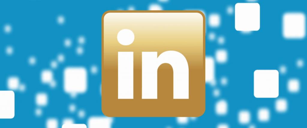 A Gold LinkedIn Logo on a blue background