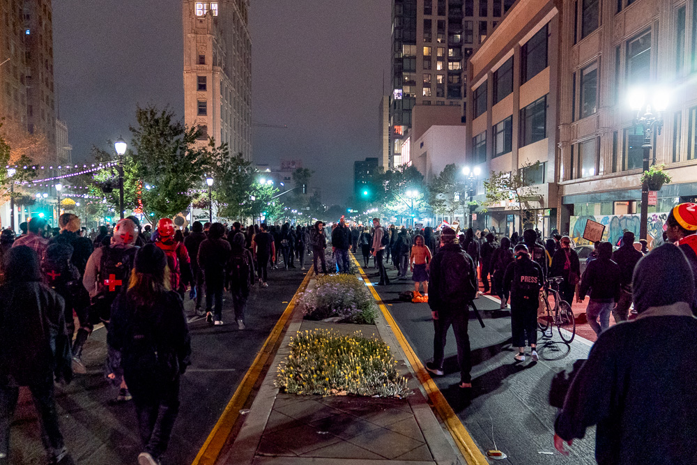 Several hundred people marched through the streets in solidarity with protests in Kenosha, Wis. during the 'Justice for Jacob' protest in Oakland, Calif., August 26, 2020.